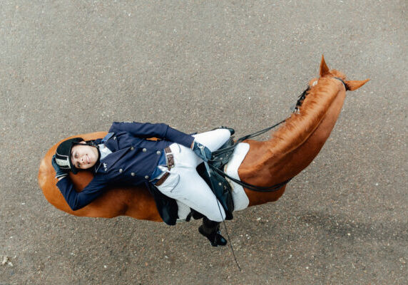 Top,View,Of,A,Girl,Lies,On,A,Horse.,Dressage